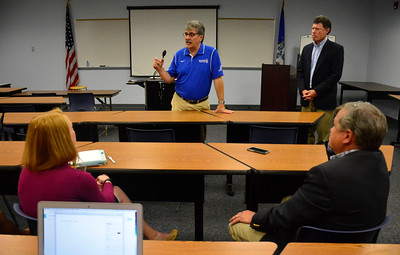 9/8/2016 Mike Orazzi | Staff State Senate Candidate Mike Nicastro  andState Senator John Fonfara talk with higher education officials, business owners and local leaders about how Bristol can qualify for grants under the innovation places program Tunxis at Bristol Thursday morning.