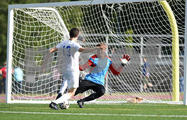 09/08/17 Wesley Bunnell | Staff Plainville Boys Soccer defeated visiting Bristol Eastern on Friday afternoon. Bristol Easterns Tom Tefoe #1 with a save against Plainvilles Jake HIllburn (13).