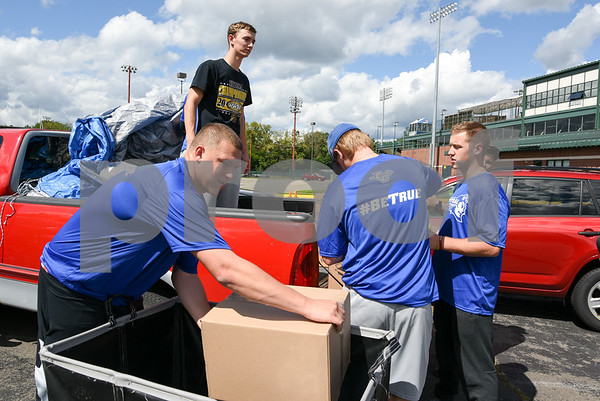 09/08/17 Wesley Bunnell | Staff A Pack the Truck event for Hurricane Harvey relief took place on Friday afternoon in the parking lot at New Britain Stadium. The event was a partnership between the New Britain Bees, Houston Astros outfielder George Springer, Siracusa Moving and Storage, A1 Automotive Repair, the Connecticut Blue Jays AAU Travel Team and Premier Limousine with trucks from Siracusa leaving for Houston following the event. CCSU Baseball student athlete Bryant Morander helps unload donations.