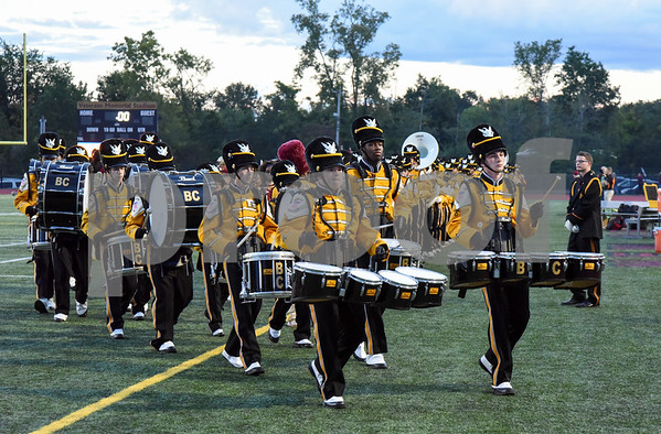 09/08/17 Wesley Bunnell | Staff New Britain High School football vs Conard at Veteran's Stadium on Friday evening. The New Britain Golden Hurricane Marching Band exits the field just prior to the start of the game.