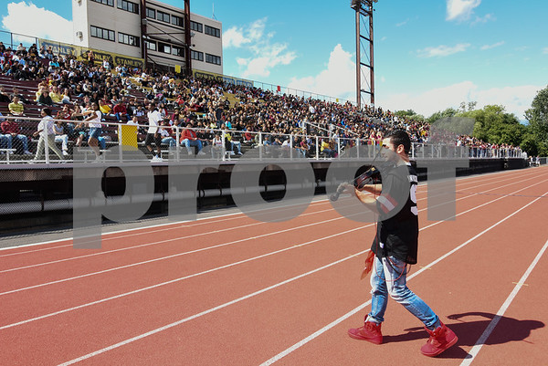 09/08/17 Wesley Bunnell | Staff New Britain High School held a pep rally at Veteran's Stadium on Friday afternoon. Matt Shredder knows as That Violin Guy performs for the students.