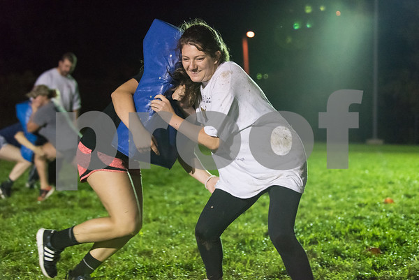 09/06/17 Wesley Bunnell | Staff CCSU women's rugby held their first practice on Wednesday September 6 after an almost 10 year absence. Kelsey Murray braces as teammate Sammy Downham makes contact with the pad.