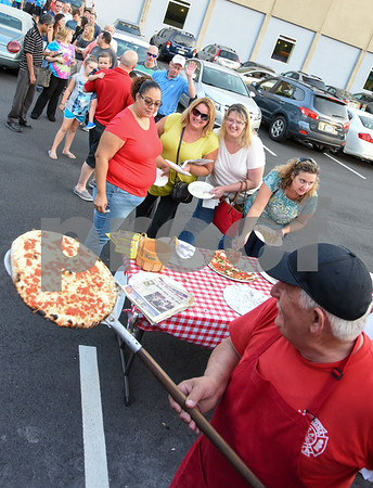 09/12/17 Wesley Bunnell | Staff The Southington Chamber of Commerce held their annual pizza festival at Crystal Bees on Tuesday evening. Owner Sal Ajro of Sal's Verona Pizza & Grill takes a fresh pie out of the oven in a converted fire truck as friends Maribel Colon, L, Kathleen Scheauble, Katherine Glenn Giguerein, Maribel Colon and Liz Bergeron wait at the head of long line.