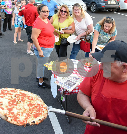 09/12/17 Wesley Bunnell | Staff The Southington Chamber of Commerce held their annual pizza festival at Crystal Bees on Tuesday evening. Owner Sal Ajro of Sal's Verona Pizza & Grill takes a fresh pie out of the oven in a converted fire truck as friends Maribel Colon, L, Kathleen Scheauble, Katherine Glenn Giguerein, Maribel Colon and Liz Bergeron wait.