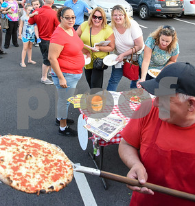 09/12/17  Wesley Bunnell   Staff  The Southington Chamber of Commerce held their annual pizza festival at Crystal Bees on Tuesday evening. Owner Sal Ajro of Sal's Verona Pizza & Grill takes a fresh pie out of the oven in a converted fire truck as friends Maribel Colon, L, Kathleen Scheauble, Katherine Glenn Giguerein, Maribel Colon and Liz Bergeron wait.