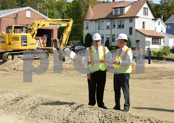 09/12/17 Wesley Bunnell | Staff A ceremonial groundbreaking was held behind the Plymouth Fire Company on Tuesday afternoon for the new seven thousand square foot addition. Firefighter and Chairman of the Building Committee for the Additions and Renovations to Plymouth Fire Company Victor Mitchell, L, speaks with Plymouth Mayor David Merchant.