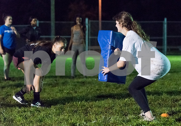 09/06/17 Wesley Bunnell | Staff CCSU women's rugby held their first practice on Wednesday September 6 after an almost 10 year absence. Junior Sammy Downham, L, practices along with Kelsey Murray holding the rucking pad.