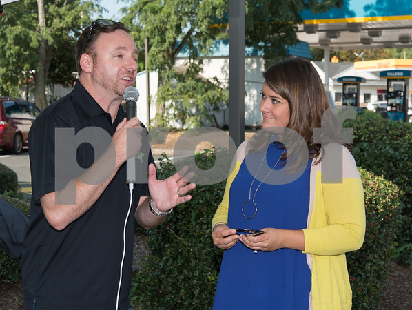 09/13/17 Wesley Bunnell   Staff Mayor Erin Stewart along with Radio 104.1 hosts David Fisch and Amy Grey collected monetary donations for Hurricane Irma Relief at McDonalds on West Main Street Wednesday afternoon. All donations benefited both people and pets through the GlobalGiving.org charity. Radio host David Fisch interviews Mayor Erin Stewart.