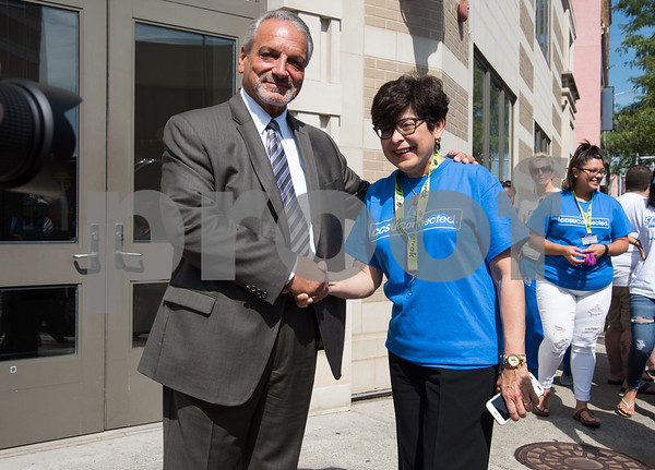 09/13/17 Wesley Bunnell   Staff CCSU students and faculty including President Dr. Zulma Toro toured downtown New Britain Wednesday afternoon on a listening tour with local business on their views of CCSU's interactions with the city. New Britain Board of Education's Chief Operating Officer Paul Salina poses for a photo with CCSU President Dr. Zulma Toro outside of the Board of Education building.