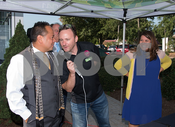09/13/17 Wesley Bunnell   Staff Mayor Erin Stewart along with Radio 104.1 hosts David Fisch and Amy Grey collected monetary donations for Hurricane Irma Relief at McDonald's on West Main Street Wednesday afternoon. All donations benefited both people and pets through the GlobalGiving.org charity. Joseph Rodriguez is interviewed by David Fisch as Mayor Erin Stewart looks on.