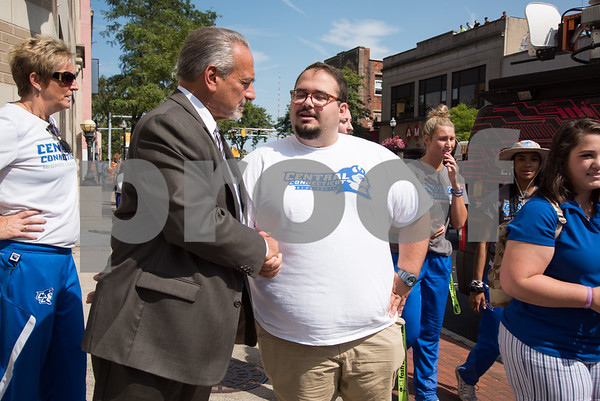 09/13/17 Wesley Bunnell   Staff CCSU students and faculty including President Dr. Zulma Toro toured downtown New Britain Wednesday afternoon on a listening tour with local business on their views of CCSU's interactions with the city. New Britain Board of Education's Chief Operating Officer Paul Salina stops to speak with Ray Rabuska an education major at CCSU.