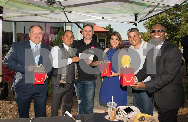 09/13/17 Wesley Bunnell   Staff Mayor Erin Stewart along with Radio 104.1 hosts David Fisch and Amy Grey collected monetary donations for Hurricane Irma Relief at McDonalds on West Main Street Wednesday afternoon. All donations benefited both people and pets through the GlobalGiving.org charity. Area Supervisor for Rodriguez Family McDonald's Ken Parrilla, L, Owner/Operator Joseph Rodriguez, radio host David Fisch, Mayor Erin Stewart, Alderman Carmelo Rodriguez and Operations Manager for Rodriguez Family McDonalds Raymond Vernet. Happy Meal containers were used to collect donations. Fish and Rodriguez hold a check in the amount of $2,500 from Rodriguez Family McDonalds.