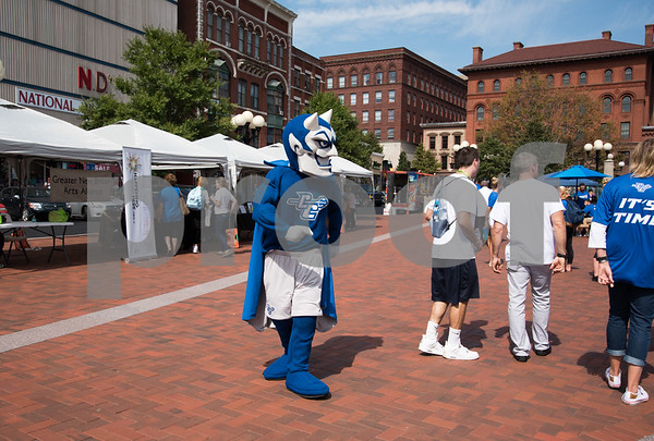 09/13/17 Wesley Bunnell   Staff CCSU students and faculty including President Dr. Zulma Toro toured downtown New Britain Wednesday afternoon on a listening tour with local business on their views of CCSU's interactions with the city. The Blue Devil mascot walks through Central Park.