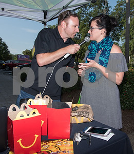 09/13/17  Wesley Bunnell | Staff  Mayor Erin Stewart along with Radio 104.1 hosts David Fisch and Amy Grey collected monetary donations for Hurricane Irma Relief at McDonald's on West Main Street Wednesday afternoon.  All donations benefited both people and pets through the GlobalGiving.org charity. Lisa Falkner of Compass Wellness Center donated on behalf of the center and is interviewed by David Fisch. The Happy Meal containers were used to collect donations.