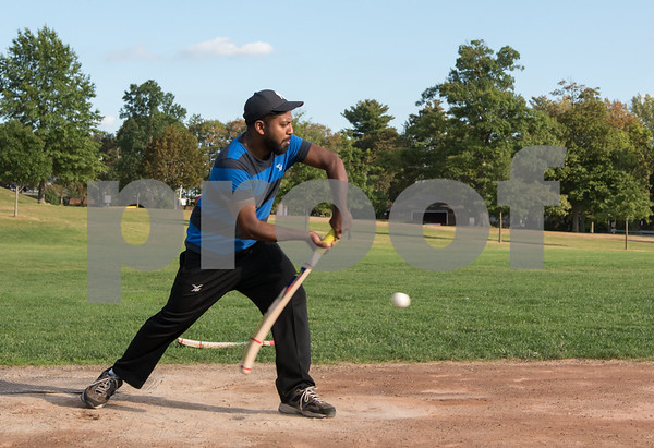 09/15/17 Wesley Bunnell | Staff Batsman Asgi Anis practices with friends on Friday evening at Walnut Hill Park in preparation for a day of matches Saturday Sep 16.