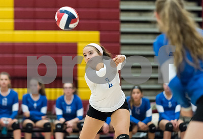 09/18/17 Wesley Bunnell | Staff  New Britain girls volleyball defeated visiting Plainville on Monday evening. Plainville's Simona Babagallo (2).