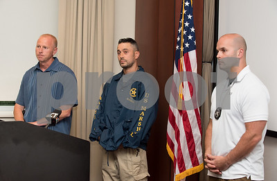 09/18/17 Wesley Bunnell | Staff  A briefing was held Monday afternoon at the New Britain Police Department regarding the apprehension of Jermaine Scott. Scott has been a fugitive since March in a triple shooting of a woman and two children. New Britain Police Captain Thomas Steck, L, U.S. Marshall Matt Duffy and U.S. Marshall task force supervisor Brian O'Neill.