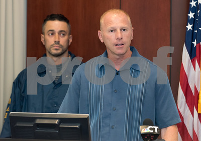 09/18/17 Wesley Bunnell | Staff  A briefing was held Monday afternoon at the New Britain Police Department regarding the apprehension of Jermaine Scott. Scott has been a fugitive since March in a triple shooting of a woman and two children. New Britain Police Captain Thomas Steck speaks as U.S. marshall Matt Duffy looks on.