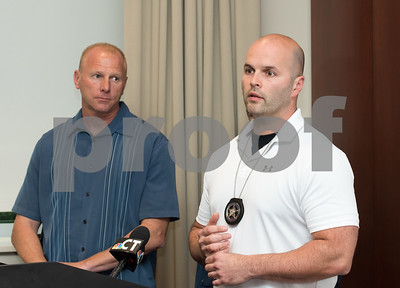 09/18/17 Wesley Bunnell | Staff  A briefing was held Monday afternoon at the New Britain Police Department regarding the apprehension of Jermaine Scott. Scott has been a fugitive since March in a triple shooting of a woman and two children. New Britain Police Captain Thomas Steck, L, and U.S. Marshall task force supervisor Brian O'Neill.
