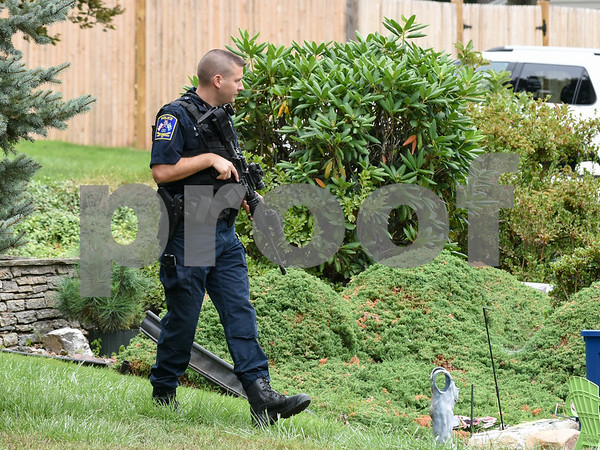 09/21/17 Wesley Bunnell | Staff A West Hartford police officer stands near the intersection of Fisk & Lloyd St in Newington on Thursday morning due to a police standoff on nearby Gilbert Rd.