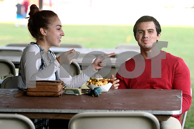 9/21/2017 Mike Orazzi | Staff Alexis Bernatchy and Michael Lamoureux while eating some nachos during the 56th Annual Chrysanthemum Festival on opening night in Bristol Thursday.