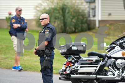 09/21/17 Wesley Bunnell | Staff  A Newington police officer blocks the intersection of Fisk & Lloyd St in Newington on Thursday morning due to a police standoff on nearby Gilbert Rd.