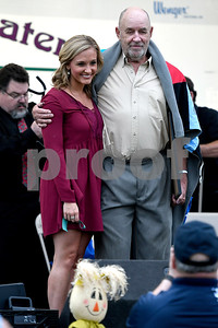9/21/2017 Mike Orazzi | Staff Hometown Hero Bob Montgomery poses with Mum Festival Grand Marshal Brittany Decker during the 56th Annual Chrysanthemum Festival on opening night in Bristol Thursday.