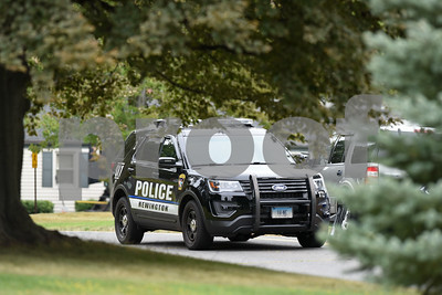 09/21/17 Wesley Bunnell | Staff  A Newington Police Car heads down Lloyd St towards Fisk Drive after a police standoff on nearby Gilbert Rd.