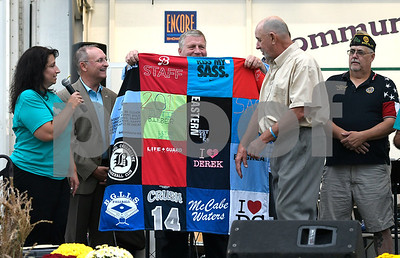 9/21/2017 Mike Orazzi | Staff Hometown Hero Bob Montgomery is presented with a quilt during the 56th Annual Chrysanthemum Festival on opening night in Bristol Thursday.