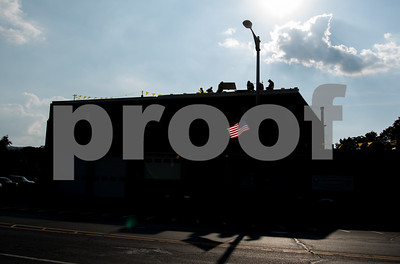 09/25/17  Wesley Bunnell | Staff  An american flag is shown against a silhouette of the Bristol Fire Department on N. Main St. on Monday afternoon as work is being performed on the departments roof.