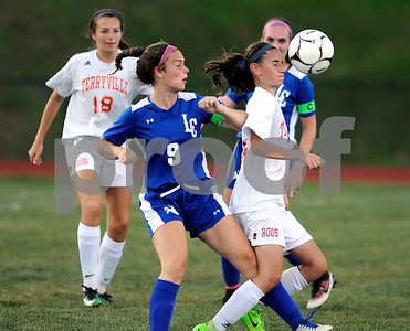 9/27/2017 Mike Orazzi | Staff Terryville's Amy Roqi (10) and Litchfield's Molly Andrulis (9) during Wednesday's soccer match at Terryville High School.