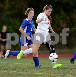 9/27/2017 Mike Orazzi | Staff Terryville's Selena Beaulieu (9)) and Litchfield's  Molly Andrulis (9) during Wednesday's soccer match at Terryville High School.
