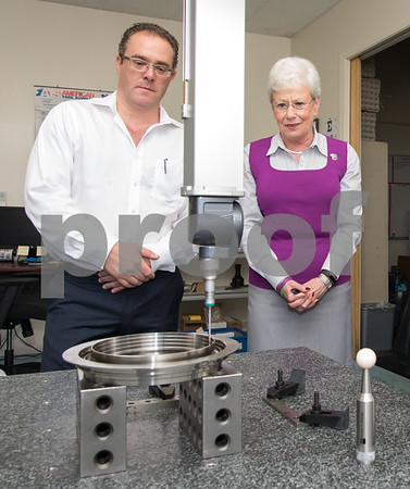 09/27/17 Wesley Bunnell | Staff Lt. Governor Nancy Wyman visited aerospace manufacture Meadow Manufacturing on Wednesday morning. The company expanded with the assistance of the state's Small Business Express program administered by the Department of Economic and Community Development. Meadow Manufacturing owner Mark Gregoretti, L, stands next to Lt. Governor Wyman, as a sample part undergoes inspection.