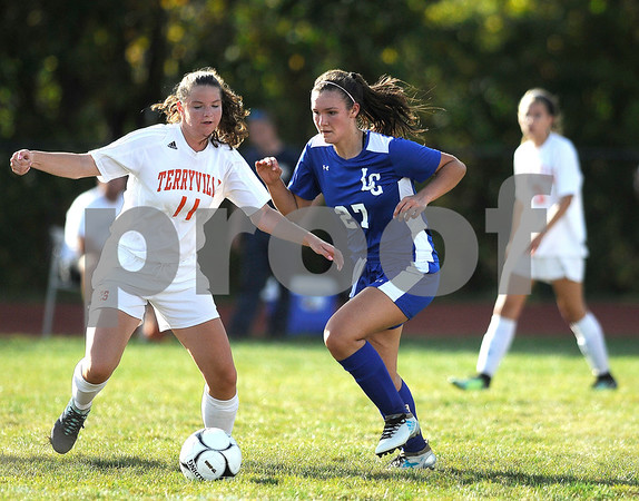 9/27/2017 Mike Orazzi | Staff Terryville's Madison Maske (11) and Litchfield's Allie Davenport (27) during Wednesday's soccer match at Terryville High School.