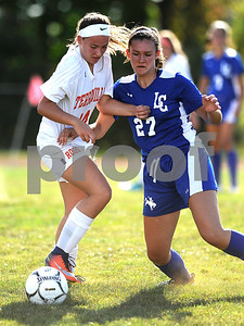 9/27/2017 Mike Orazzi | Staff Terryville's Amy Ieronimo (14) and Litchfield's  Allie Davenport (27) during Wednesday's soccer match at Terryville High School.