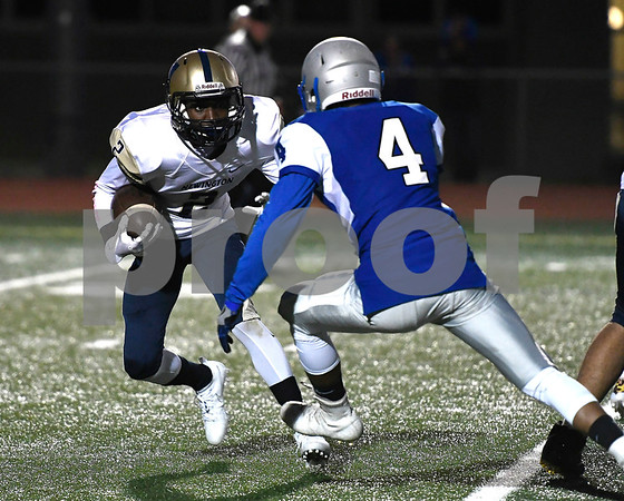 9/28/2017 Mike Orazzi | Staff Newington's Carlum Caldwell (2) and Bristol Eastern's Dayton Forges (4) during Thursday night's football game in Bristol.