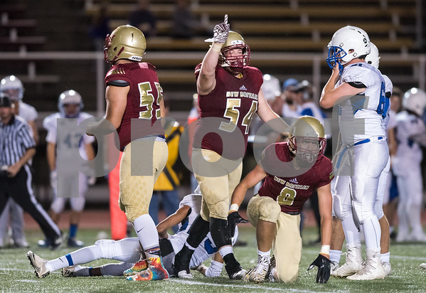09/28/17 Wesley Bunnell | Staff New Britain vs Hall on Thursday night at Veteran's Stadium. Jacob Clark (54) motions after a tackle for a loss.