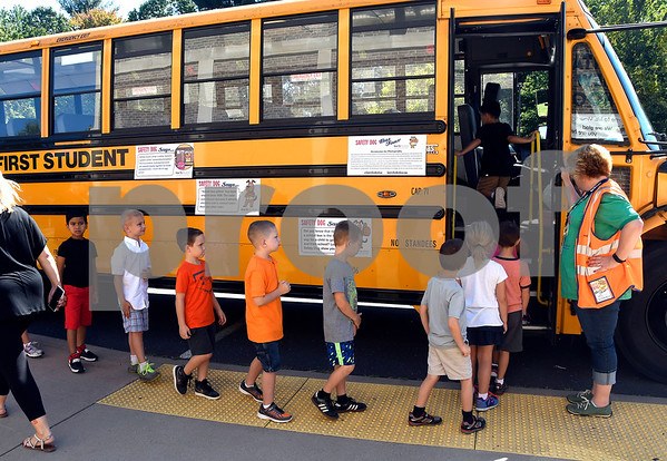 9/28/2017 Mike Orazzi | Staff First Student's Kelly Pigeon escorts children onto a bus during a bus safety demonstration at the Mt. View Elementary School in Bristol Thursday morning.
