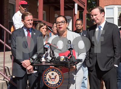09/29/17  Wesley Bunnell | Staff  Sen. Richard Blumenthal and Sen. Chris Murphy met with leaders of the Puerto Rican community at Aqui Me Quedo Restaurant in Hartford to discuss ways to help the island after Hurricane Maria. Lissette Colon of Bridgeport speaks at the podium as Sen. Blumenthal, L, and Sen. Murphy look on.