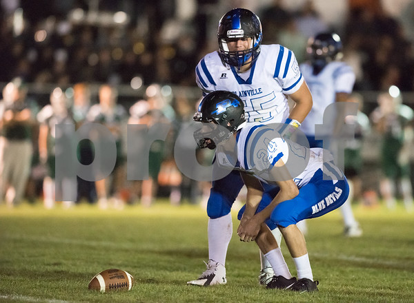 09/29/17 Wesley Bunnell | Staff Plainville football vs Northwest Catholic in West Hartford on Friday night. Jared Riback (24) crouches as he waits for play to resume while Justin Ciotto (55) talks.