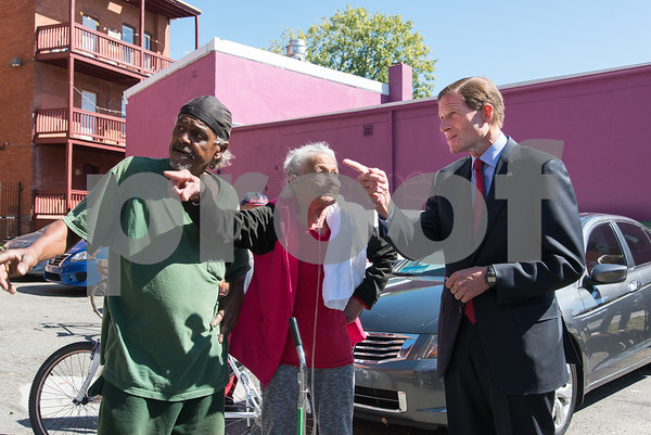 09/29/17 Wesley Bunnell | Staff Sen. Richard Blumenthal and Sen. Chris Murphy met with leaders of the Puerto Rican community at Aqui Me Quedo Restaurant in Hartford to discuss ways to help the island after Hurricane Maria. Local residents Awildo Otero, L, and Maria Perez speak with Sen. Blumenthal and point out their building.