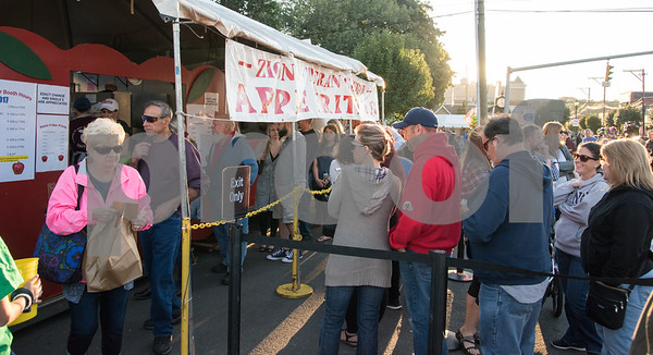 09/29/17 Wesley Bunnell | Staff A large que of visitors wait in line for the Zion Lutheran Church apple fritters booth at the 49th Annual Southington Apple Harvest Festival which kicked off on Friday night. The festival is running through October 8th.