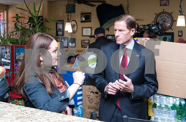 09/29/17 Wesley Bunnell | Staff Sen. Richard Blumenthal and Sen. Chris Murphy met with leaders of the Puerto Rican community at Aqui Me Quedo Restaurant in Hartford to discuss ways to help the island after Hurricane Maria. Kristina Diaz, who stopped by to pick up lunch speaks with Sen. Blumenthal as they stand in front of supplies being donated to help the people of Puerto Rico.