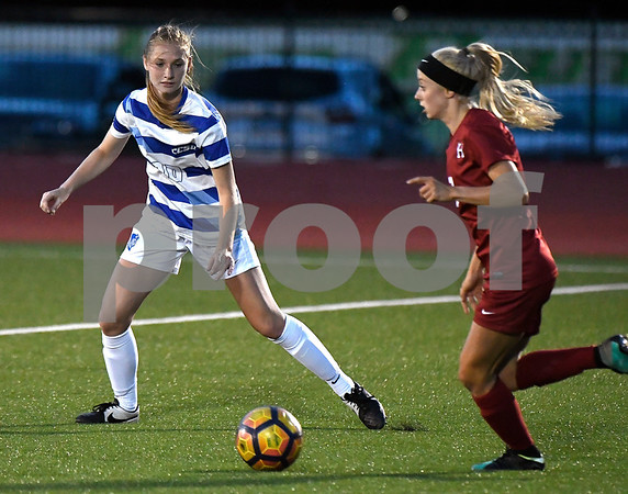 9/1/2017 Mike Orazzi | Staff CCSU's Danielle Pearse (10) and Harvard's Meg Tveit (7) during the CCSU Soccer Tournament in New Britain Friday night.