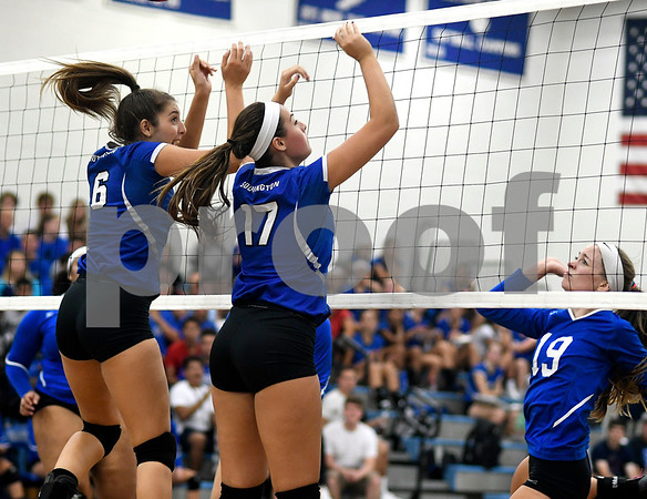 9/13/2017 Mike Orazzi | Staff Southington's Erica Bruno (6) and Brooke Cooney (17) at the net with Bristol Eastern's Amber Blais (19) Wednesday night.