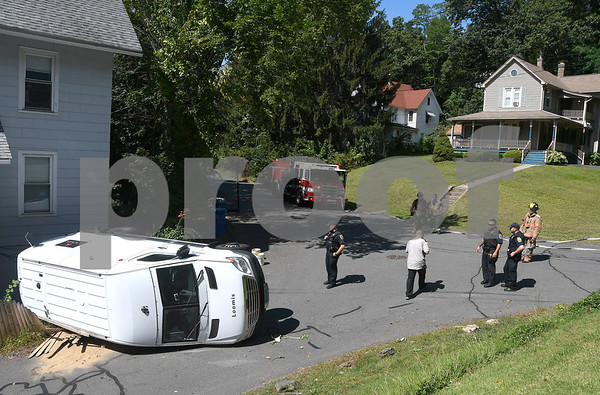9/13/2017 Mike Orazzi | Staff The scene of an armored truck rollover at the intersection of Ingraham Street and Hungerford Alley in Bristol Wednesday afternoon. The driver was not injured and was help from the vehicle by some good samaritans.