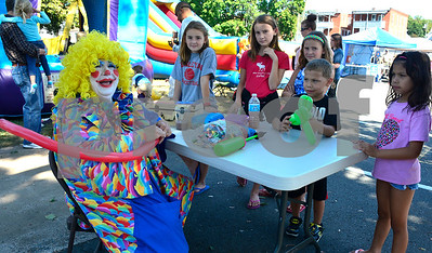 9/16/2016 Mike Orazzi | Staff Flower while making balloon animals during Immanuel Lutheran's one day German Festival Saturday in Bristol.