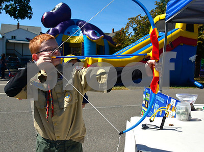 9/16/2016 Mike Orazzi | Staff Adam Krueger shoots a bow and arrow while at the Immanuel Lutheran's one day German Festival Saturday in Bristol.