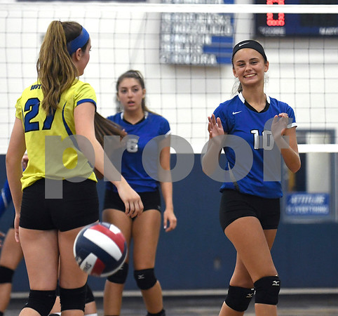 9/13/2017 Mike Orazzi | Staff Southington's Nolyn Allen (27) and Jenna Martin (10) Wednesday night.