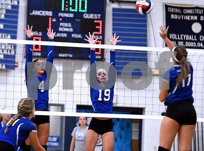 9/13/2017 Mike Orazzi | Staff Bristol Eastern's Olivia Beaudoin (4) and Amber Blais (19) and Southington's Brooke Cooney (17) Wednesday night.